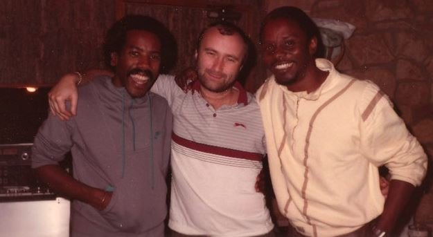 Phil Collins, Nathan East, and Philip Bailey.