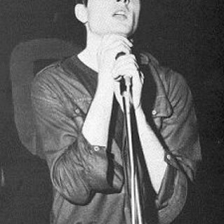 Ian Curtis performing with Joy Division