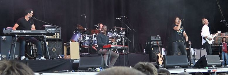 Mike and the Mechanics performing live.